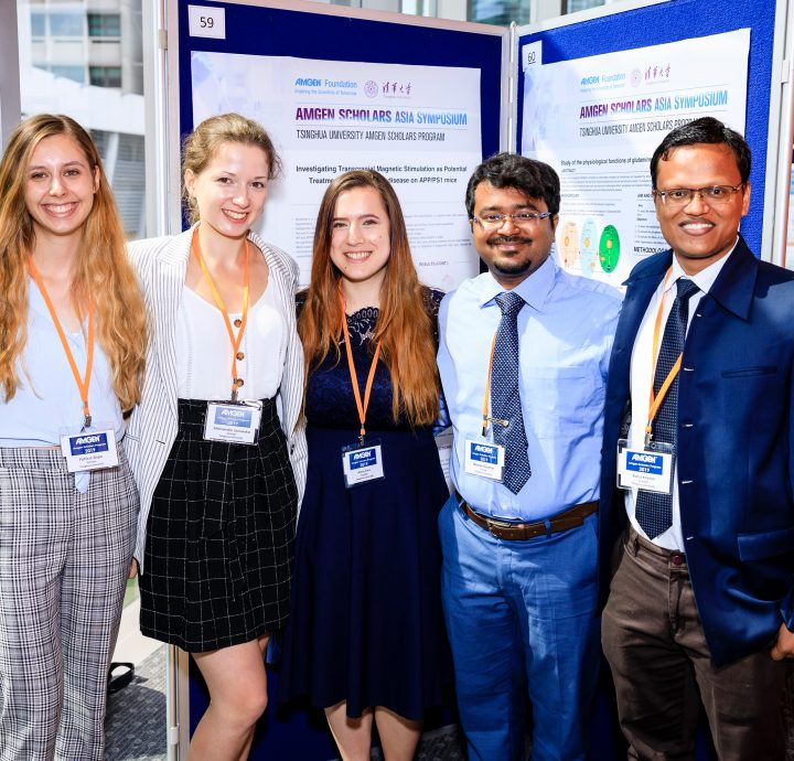Scholars and speakers at poster session